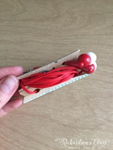 Use clothespins to hold earbuds for little hands in the classroom