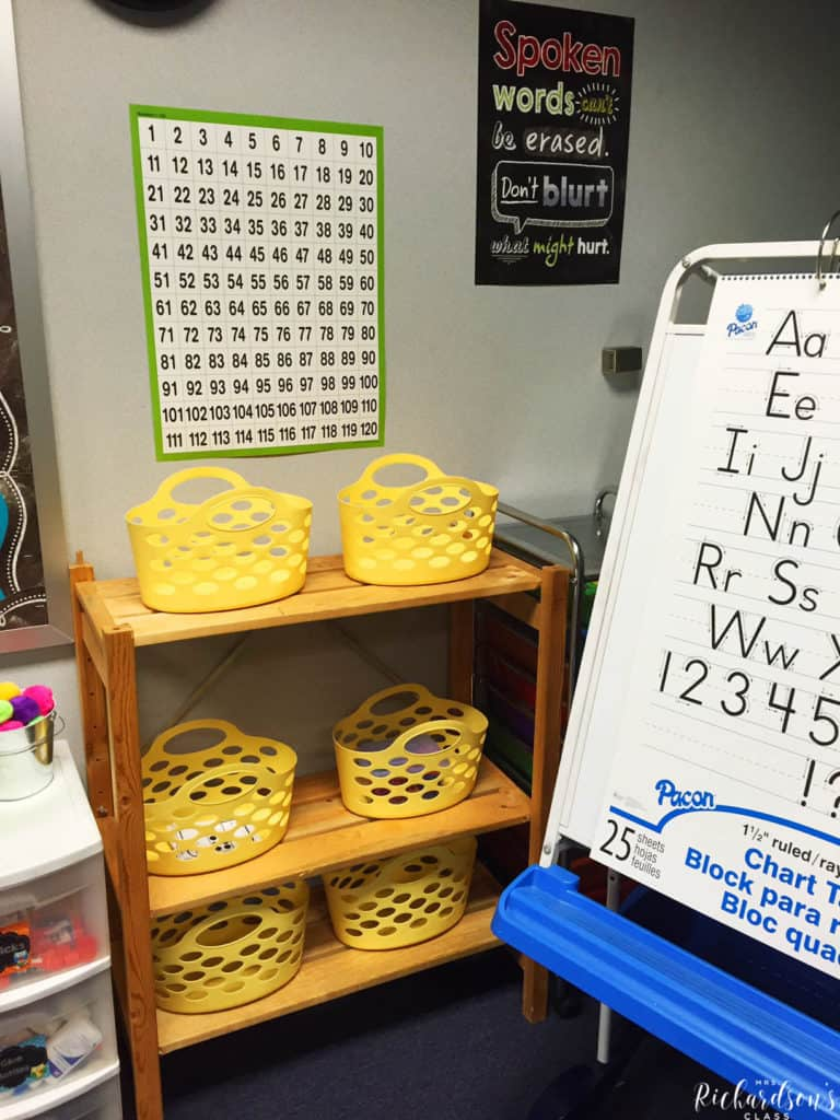 This shelf houses simple baskets that can serve as math station storage, early finisher tubs, or store math manipulatives even!