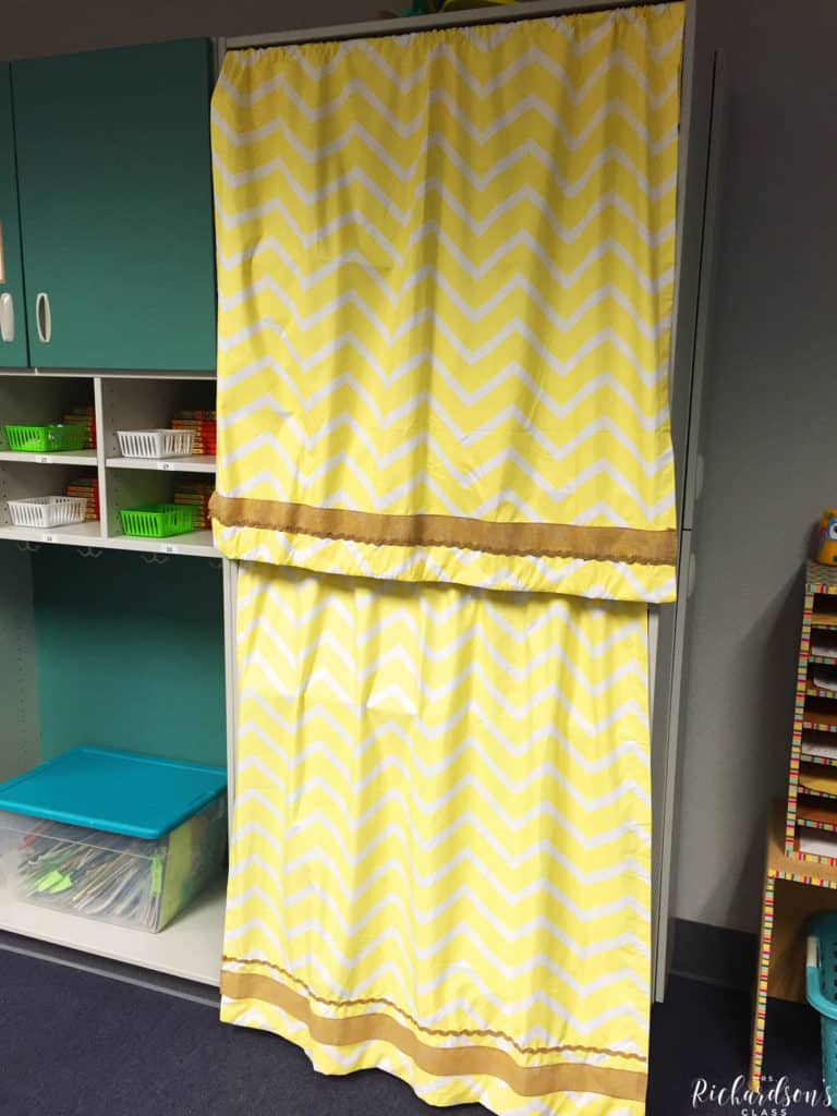 These yellow curtains are trimmed with burlap and hide teacher supplies perfectly!