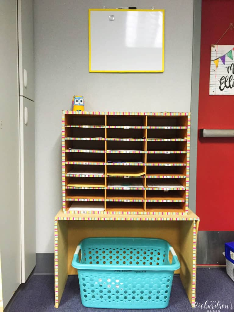 These student mail boxes are trimmed with colorful wash tape. The laundry basket under is for students to put their lunch boxes in during the morning.
