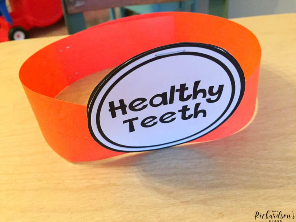"Learn all about dental health and share what little learners learned with this dentist craft! Make a dentist hat with facts written in the ""light"". Perfect for kindergarten and first grade dental health activities."